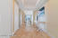 Luxurious gallery foyer with marble flooring