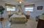 Gorgeous terrazzo floors in nice sized guest bedroom.