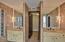 Double sinks, toilet, bidet & shower.