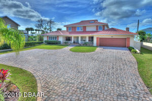 Custom designed home with expansive driveway offering plenty of parking for guest.