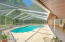 Enclosed pool area has an over hang to protect your patio furniture from sun and rain