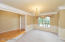 Foyer has hardwood flooring. Dining room with double crown molding and chair rail molding.