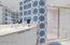 Custom wallpaper in all bathrooms