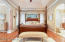 Master bedroom with custom stain glass window