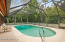 Larger pool with screen enclosure. Pool cleaner is included.