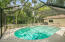 View of pool to back yard and reserve area