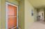 Front door with windowed secondary door that can open as a screen door to let in the breezes.