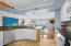 Kitchen overlooks dining with spectacular water views.