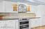 Granite counters, designer tile backsplash, new stainless steel appliances.