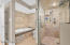 Master bath walk in shower with ledge and large tub. Designer tile with listellos.
