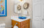Powder room with corian counters and designer cobalt blue sink.