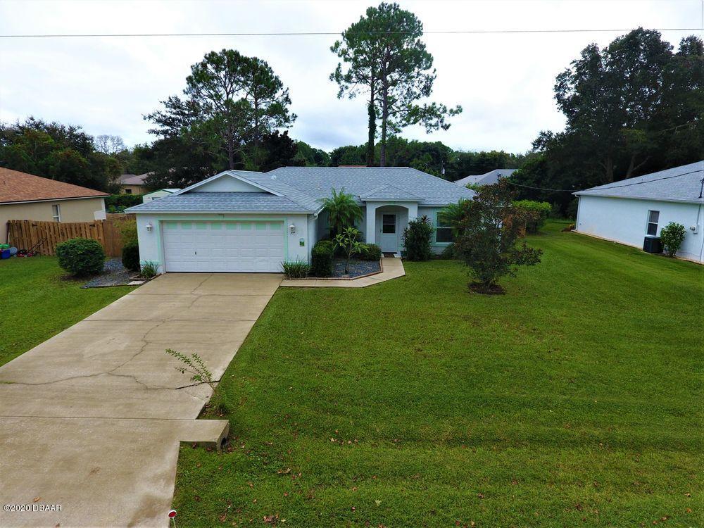 Photo of 34 Pebble Wood Lane, Palm Coast, FL 32164