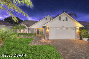 Lovely lakefront home beautifully maintained located in the 24 hour guard gated community of Spruce Creek Fly-In.