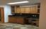 Built in desk area and plenty of cabinet and counter top space Pantry also