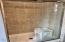 tile shower in master bathroom