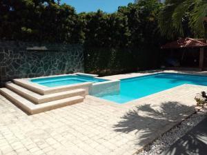 Casa En Ventaen Distrito Nacional, Bella Vista, Republica Dominicana, DO RAH: 20-1718