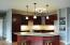 Quality cabinetry, under cabinet lighting and granite countertops
