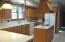 Large Kitchen with Center Island, Oak Cabinets and Corian Countertops.