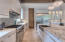 2 dishwashers, 6 burner gas range, huge refrigerator and freezer, yards of cabinets