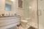 Full bath with full tiled shower