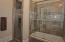 Guest Bath II with natural stone tile