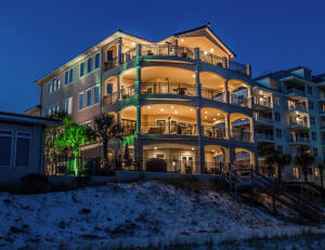 This 4 story home was built to commercial standards and offers private beach access and pool.