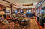 Open Entertainment Floor with Wet Bar, Gaming Tables and Theater Room.