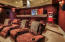 State of the art equipment in this tiered level, sound proof, theater room with the most comfortable reclining chairs.