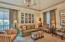 Decorated in hues of coral and sage, this room is enhanced with built in cabinetry, private bathroom and large walk in closet.