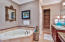 Jetted tub, walk in shower, double vanities, and timeless granite counter tops.