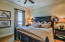 Carpetted king bedroom, gulf view, and private bath with tub/shower combination.