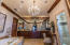 Size and elegance are the story here with marble and granite details, 2 walk in closets, double vanities, walk in steam shower, jetted tub. The room encompasses an approx 20'x 20' space.