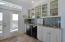 Custom Cabinets, granite counters, glass tiled backsplash in the Wet Bar on Level 2