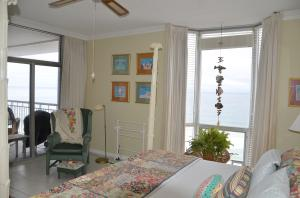 Master bedroom also has its own sliding glass door to the balcony.