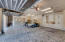 Three plus car garage is 40x24 and has a golf cart area as well as abundant custom designed storage.