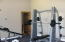 Fully equipped fitness room with full bath