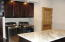 Residence laundry / mud room with granite and custom cabintry