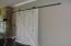 Custom hanging/slider door to master bedroom