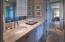 2 en-suite baths that both have walk out showers