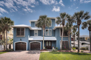 This Gulf Front home has two car garage, driveway parking for 8 , private 1st floor guest entrance, and expansive grass yard!
