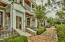 Brick walkway to your townhome with an iron fence on your patio