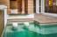 Pool with swim up bar seating