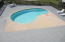 Sizable heated pool with huge deck/lounge area