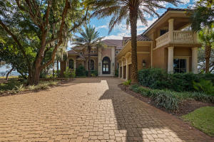 Welcome to this incredible bay front home with deepwater boatslip and 7,524 sq ft of luxury living area.