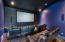"Media room with 119"" projection screen."