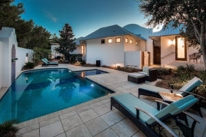30' private pool and lounge area w/ outdoor dining space, grilling area, multiple loungers, and outdoor shower