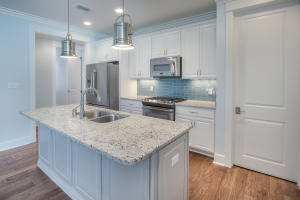 The beautiful kitchen features stainless appliances, a gas range, and a full pantry.