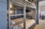 4 full built-in bunks that can be closed off from bonus and media rooms