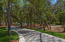 A long driveway leads the way to a majestic 1.81 acre expanse.