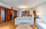 All concrete floors and rich wood paneling